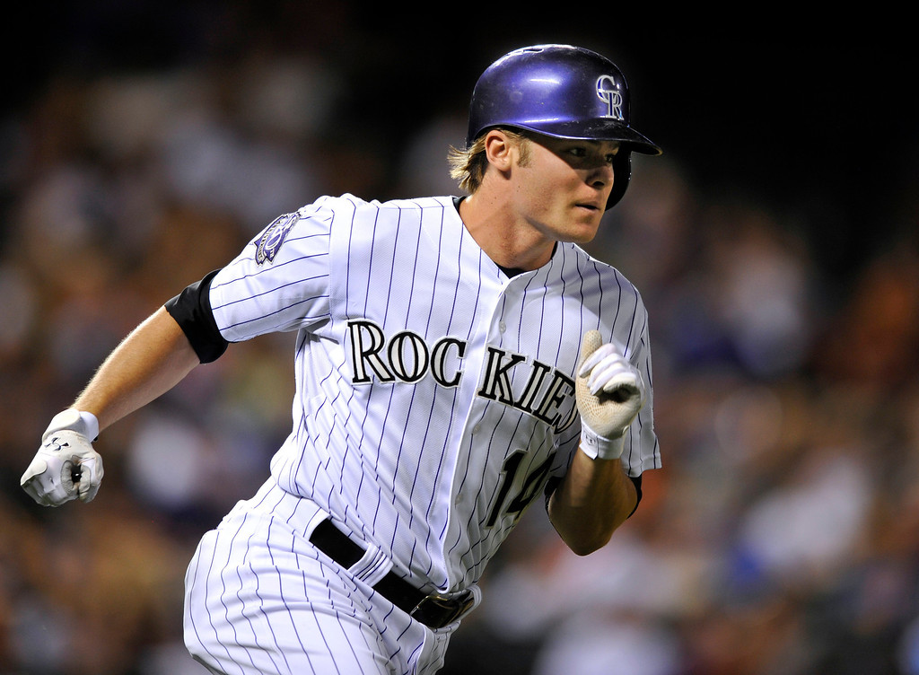 . Colorado Rockies\' Josh Rutledge rounds the bases after hitting a solo home run off Los Angeles Dodgers relief pitcher Paco Rodriguez during the eighth inning of a baseball game, Tuesday, Sept. 3, 2013, in Denver. (AP Photo/Jack Dempsey)