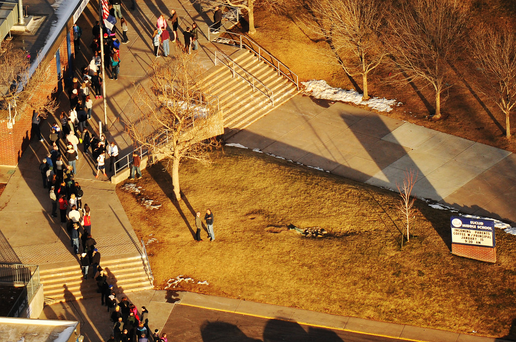 . LITTLETON, CO. DECEMBER 13: People line up outside of Euclid Middle School, one of the reunification centers, following a shooting incident at Arapahoe High School in Centennial, Colorado December 13, 2013. (Photo by Hyoung Chang/The Denver Post)