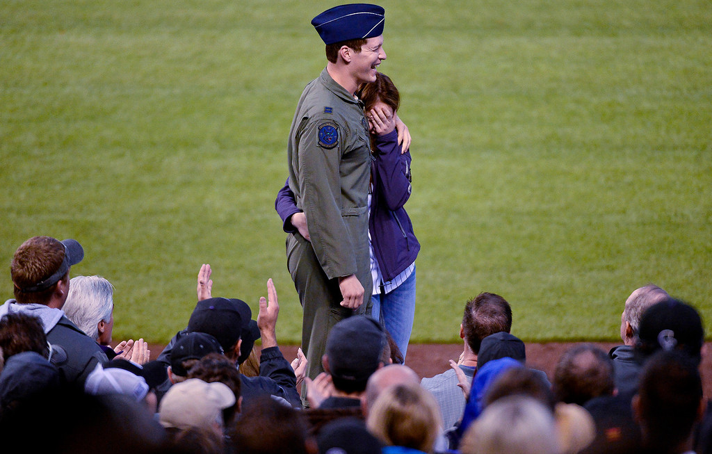 . DENVER, CO. - MAY 20: United States Air Force Capt. Daniel Kulp 28-years-old with the 17 Special Operations Squadron surprises his sister Anna Kulp 18-years-old on top of the dugout at the Colorado Rockies Arizona Diamondbacks game May 20, 2013 at Coors Field. Daniel stationed in Japan came home to see his sister graduate from Center High School in Center, Colorado. (Photo By John Leyba/The Denver Post)