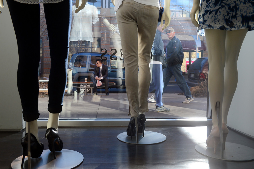 . Pedestrians pass Guess, Inc. at Belmar in Lakewood, CO, January 22, 2013. (Photo By Craig F. Walker / The Denver Post)
