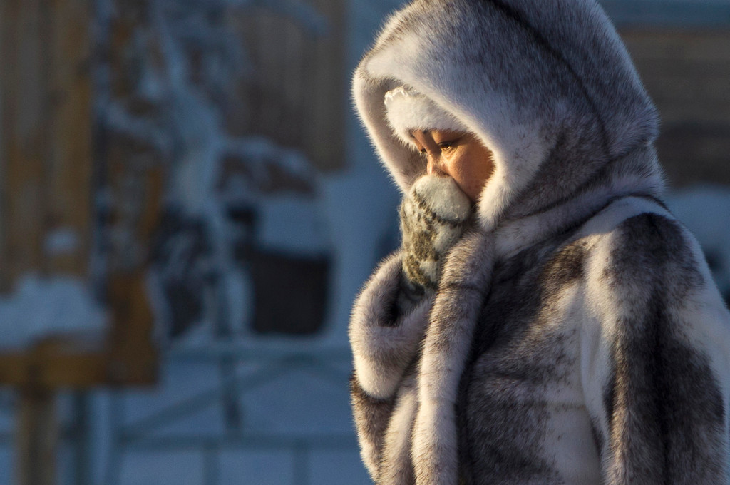. A woman wrapped in fur is pictured in the village of Tomtor in the Oymyakon valley, in the Republic of Sakha, northeast Russia, January 28, 2013. The coldest temperatures in the northern hemisphere have been recorded in Sakha, the location of the Oymyakon valley, where according to the United Kingdom Met Office a temperature of -67.8 degrees Celsius (-90 degrees Fahrenheit) was registered in 1933 - the coldest on record in the northern hemisphere since the beginning of the 20th century. Yet despite the harsh climate, people live in the valley, and the area is equipped with schools, a post office, a bank, and even an airport runway (albeit open only in the summer). Picture taken January 28, 2013. REUTERS/Maxim Shemetov