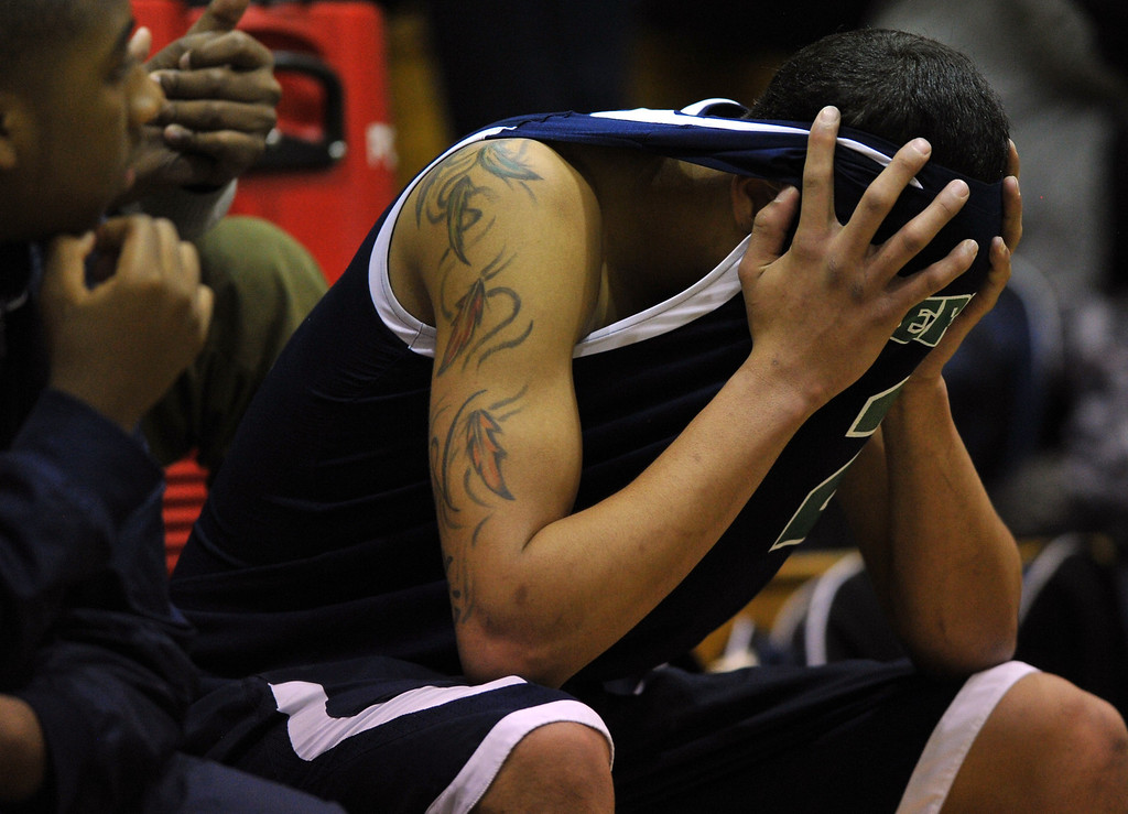 . HIGHLANDS RANCH, CO. - MARCH 02: Taren Williams of Overland High School holds head after losing the 2nd round of 5A playoff game against ThunderRidge High School. March 2, 2013. Highlands Ranch, Colorado. ThunderRidge won 67-57. (Photo By Hyoung Chang/The Denver Post)