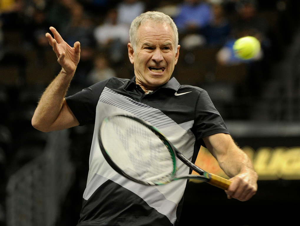 . John McEnroe returned a shot against Jim Courier in a match won by McEnroe 6-4 Thursday night. McEnroe faced Jim Courier in an exhibition match at the Pepsi Center Thursday night, November 29, 2012. McEnroe is ranked second behind Courier in the 2012 PowerShares Series tour. Karl Gehring/ The Denver Post