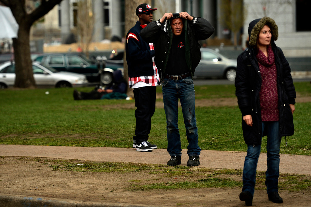 . DENVER, CO. - APRIL 20: April 20: People on the street are watchful near Civic Center Park in Denver Colorado after the 4/20 pot rally where two people were shot during Saturday\'s annual 4/20 marijuana rally, held on a day cannabis enthusiasts regard as a holiday called 4/20 that drew tens of thousands to Denver\'s Civic Center park. This is the first 4/20 marijuana rally since Colorado voters legalized marijuana use for people 21 and older in November. April 20, 2013 Denver, Colorado. (Photo By Joe Amon/The Denver Post)