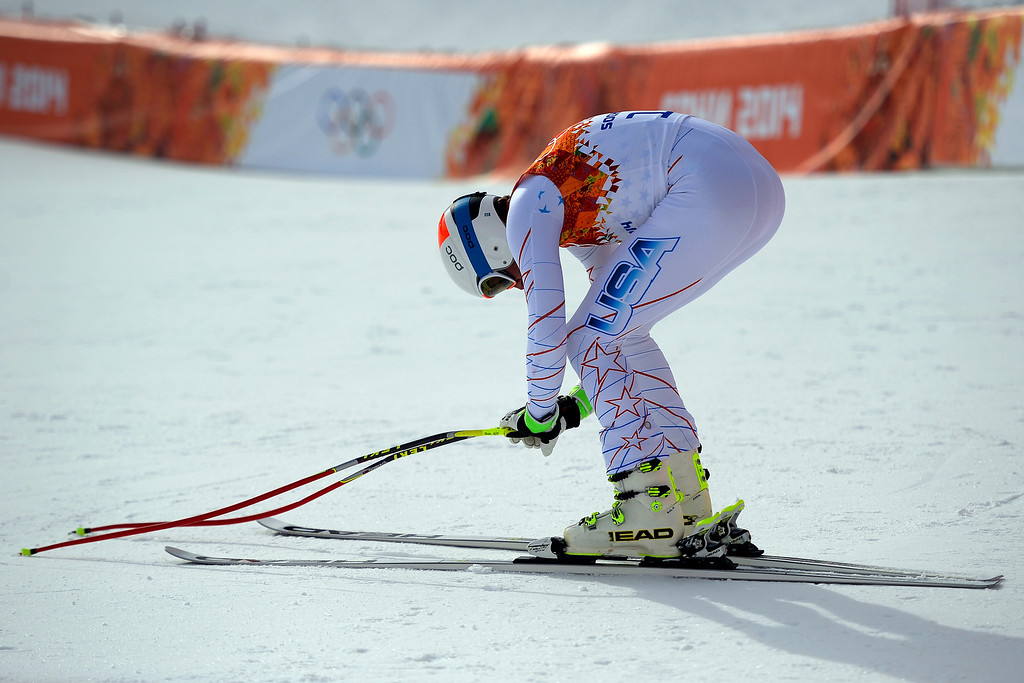 . United States skier Bode Miller bends over in disappointment after failing to crack the top three during the alpine skiing men\'s downhill final. Sochi 2014 Winter Olympics at the Rosa Khutor Alpine Resort on Sunday, February 9, 2014. (Photo by AAron Ontiveroz/The Denver Post)