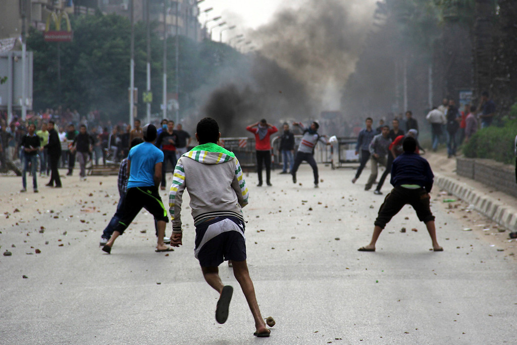 . Muslim Brotherhood protesters throw stones at security forces during clashes  in Cairo, Egypt, 29 November 2013.  EPA/MOHAMED KAMAL/ALMASRY ALYOUM