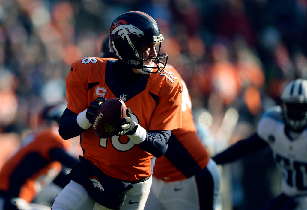 . DENVER, CO - DECEMBER 8: Denver Broncos quarterback Peyton Manning (18) looks for a receiver during the first quarter.  The Denver Broncos vs. the Tennessee Titans at Sports Authority Field at Mile High in Denver on December 8, 2013. (Photo by Hyoung Chang/The Denver Post)