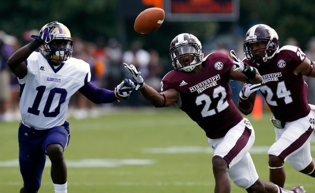 . Mississippi State linebacker Matthew Wells (22) unsuccessfully tries to catch a blocked first-quarter pass-attempt by Alcorn State quarterback Zerick Rollins Jr. (10) during their NCAA college football game at Davis Wade Stadium, Saturday, Sept. 7, 2013, in Starkville, Miss. (AP Photo/Rogelio V. Solis)