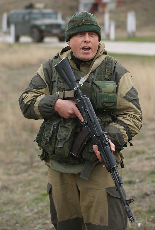 . A soldier under Russian command warns anyone approaching further that he will shoot them in the legs after he and colleagues fired their weapons into the air and screamed orders to turn back at an approaching group of over 100 hundred unarmed Ukrainian troops at the Belbek airbase, which the Russian troops are occupying, in Crimea on March 4, 2014 in Lubimovka, Ukraine.  (Photo by Sean Gallup/Getty Images)