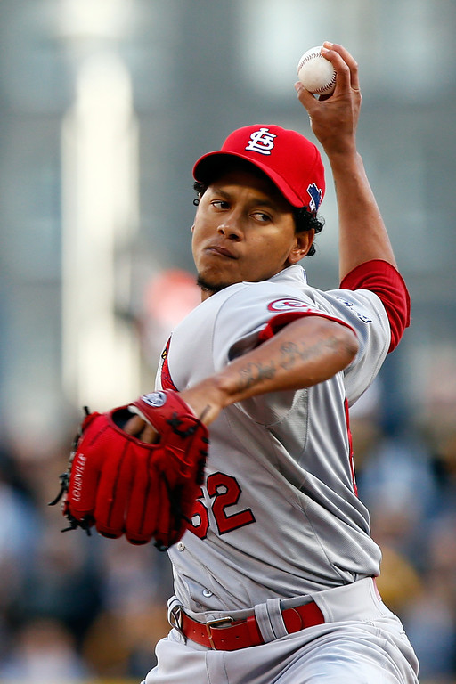 . Carlos Martinez #62 of the St. Louis Cardinals throws a pitch against the Pittsburgh Pirates in the eighth inning during Game Four of the National League Division Series at PNC Park on October 7, 2013 in Pittsburgh, Pennsylvania.  (Photo by Jared Wickerham/Getty Images)
