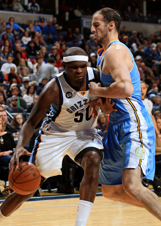 . Memphis Grizzlies forward Zach Randolph (50) drives against the defense of Denver Nuggets center Kosta Koufos (41) during the first half of their NBA basketball game in Memphis, Tennessee December 29, 2012.  REUTERS/Nikki Boertman (UNITED STATES - Tags: SPORT BASKETBALL)