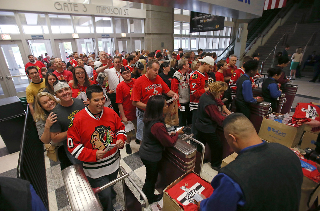 . Fans line up at the turnstiles as they wait to be let into the coucourse of the arena to watch the Chicago Blackhawks host the Boston Bruins in Game one of the 2013 Stanley Cup Final at United Center on June 12, 2013 in Chicago, Illinois.  (Photo by Jonathan Daniel/Getty Images)