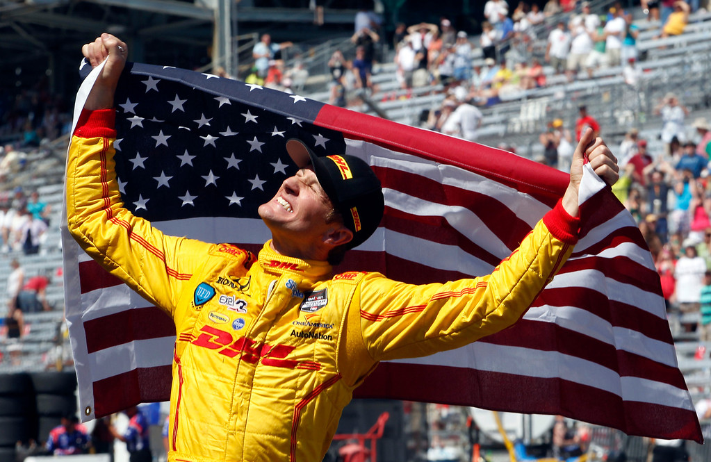 . Ryan Hunter-Reay celebrates after winning the 98th running of the Indianapolis 500 IndyCar auto race at the Indianapolis Motor Speedway in Indianapolis, Sunday, May 25, 2014. (AP Photo/Tom Strattman)
