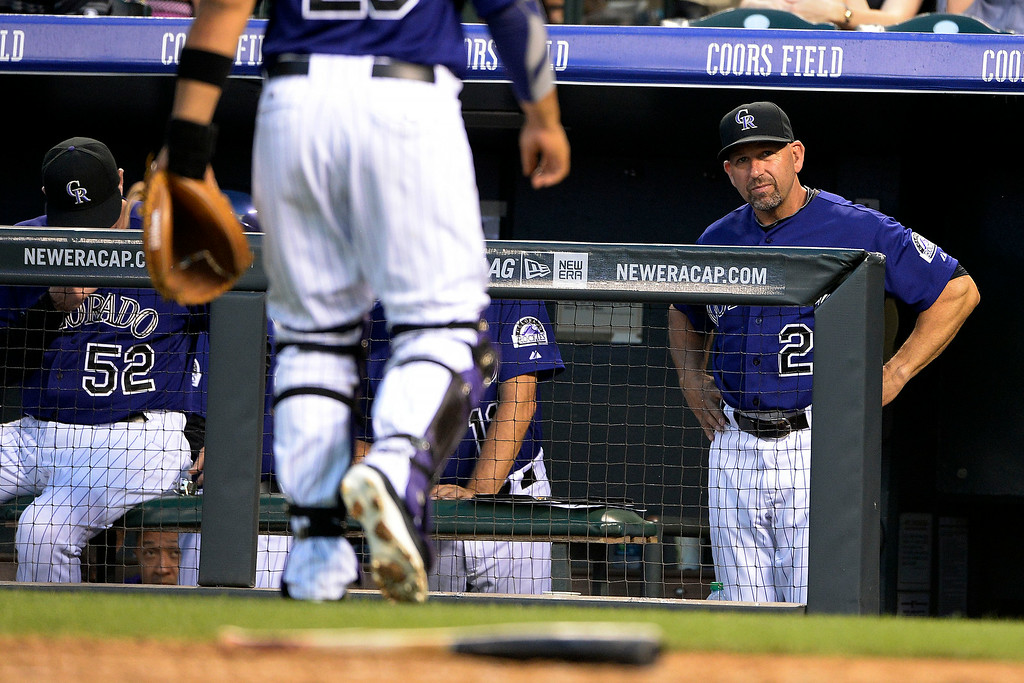 . Colorado Rockies manager Walt Weiss watches the action against the Washington Nationals at Coors Field. Major League Baseball action between the Colorado Rockies and the Washington Nationals on Monday, July 21, 2014. (Photo by AAron Ontiveroz/The Denver Post)