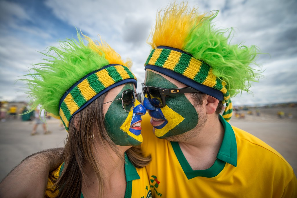 . Fans of Brazil kiss as they arrive at Mineirao stadium, in Belo Horizonte, Brazil, before the start of the FIFA World Cup semi-final match between Brazil and Germany, on July 8, 2014.  AFP PHOTO / GUSTAVO  ANDRADE/AFP/Getty Images