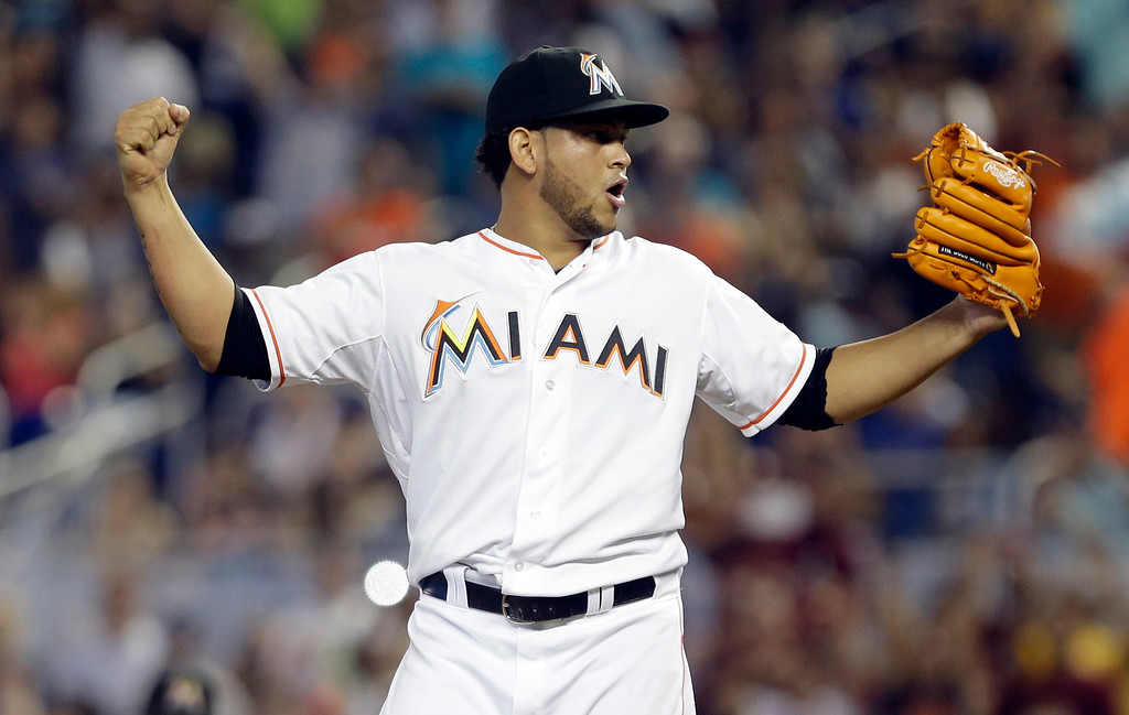 . Miami Marlins\' Henderson Alvarez celebrates after striking out Detroit Tigers\' Matt Tuiasosopo for the last out of the ninth inning of an interleague  baseball game on Sunday, Sept. 29, 2013, in Miami. Alvarez got a no-hitter as the Marlins won 1-0. (AP Photo/Alan Diaz)