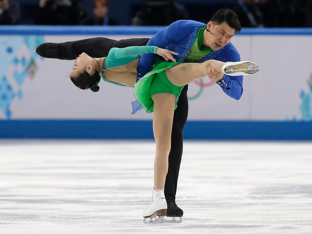 Description of . Peng Cheng and Zhang Hao of China compete in the pairs short program figure skating competition at the Iceberg Skating Palace during the 2014 Winter Olympics, Tuesday, Feb. 11, 2014, in Sochi, Russia. (AP Photo/Darron Cummings)