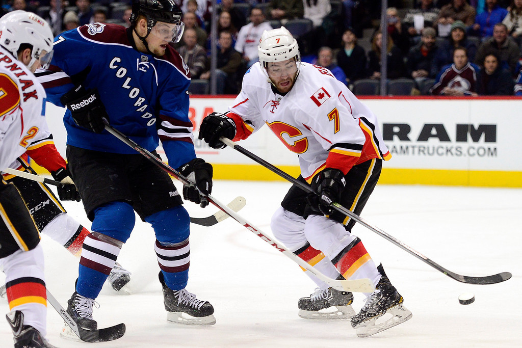 . John Mitchell (7) of the Colorado Avalanche defends T.J. Brodie (7) of the Calgary Flames during the first period.  (Photo by AAron Ontiveroz/The Denver Post)