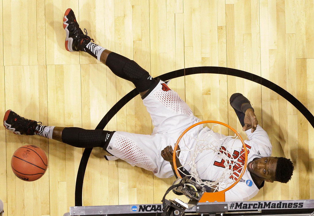 . Louisville\'s Montrezl Harrell looks up after falling on the floor during the second half of an NCAA Midwest Regional semifinal college basketball tournament game against the Kentucky Friday, March 28, 2014, in Indianapolis. (AP Photo/Michael Conroy)