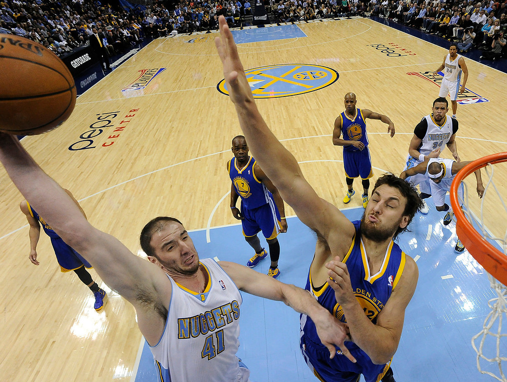. Denver Nuggets center Kosta Koufos (41) puts up a shot against Golden State Warriors center Andrew Bogut (12). The Denver Nuggets took on the Golden State Warriors in Game 5 of the Western Conference First Round Series at the Pepsi Center in Denver, Colo. on April 30, 2013. The Nuggets center Kosta Koufos was traded to the Memphis Grizzlies in exchange for Darrell Arthur and the 55th pick in the 2013 NBA Draft.   (Photo by John Leyba/The Denver Post)