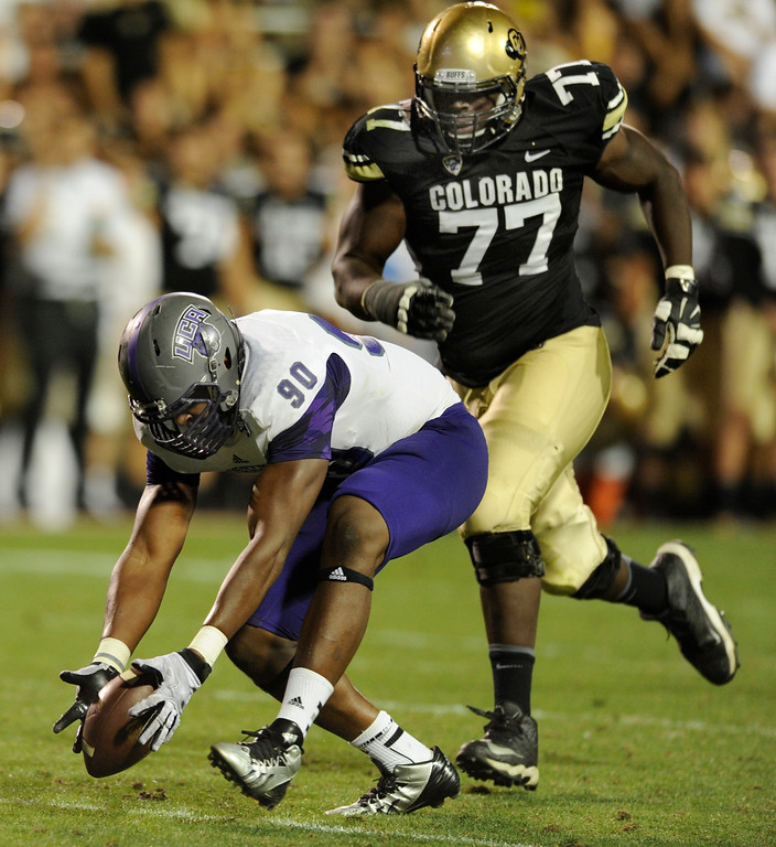. BOULDER, CO. - SEPTEMBER 76: ACU defensive end Jonathan Woodard (90) scooped up a Connor Wood fumble in the second half. The University of Colorado football team hosted Central Arkansas at Folsom Field Saturday night, September 7, 2013. Photo By Karl Gehring/The Denver Post