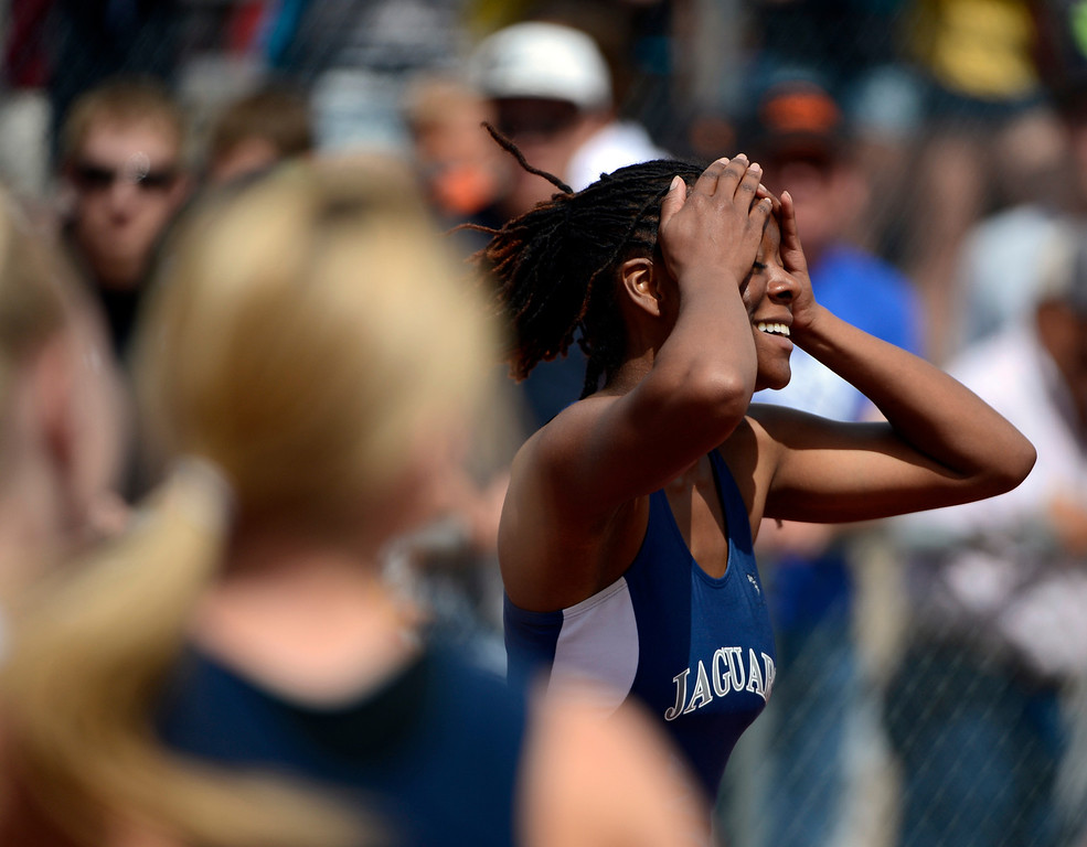 . Alicia Lawrence, of James Irwin High School, celebrates after winning the girls 3A 100 meter dash at the Colorado State Track and Field Championships at Jeffco Stadium, Saturday morning, May 18, 2013. (AP Photo/The Denver Post, Andy Cross)