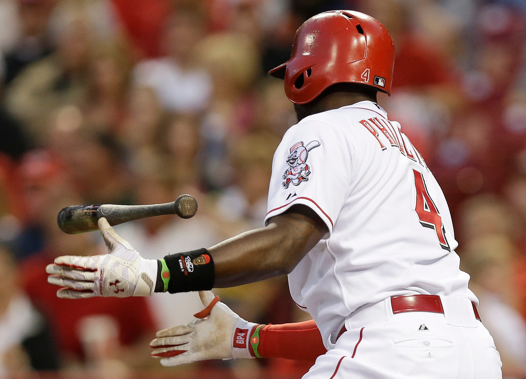 . Cincinnati Reds\' Brandon Phillips tosses his bat after striking out against Colorado Rockies starting pitcher Jordan Lyles in the fourth inning of a baseball game on Saturday, May 10, 2014, in Cincinnati. (AP Photo/Al Behrman)