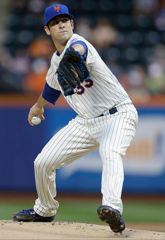 . New York Mets pitcher Matt Harvey winds up during the first inning of a baseball game against the Colorado Rockies on Wednesday, Aug. 7, 2013, in New York.(AP Photo/Frank Franklin II)