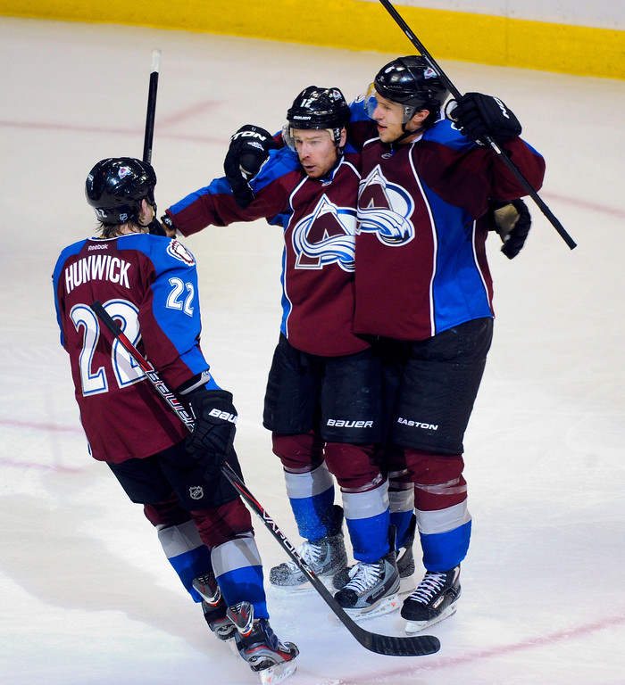 . DENVER, CO. - MARCH 12: Erik Johnson (6) and Matt Hunwick (22) congratulated Chuck Kobasew (12) of the Colorado Avalanche following his tie-breaking goal in the third period. The Colorado Avalanche came back to beat the Dallas Stars 4-3 Wednesday night, March 19, 2013 at the Pepsi Center in Denver. (Photo By Karl Gehring/The Denver Post)
