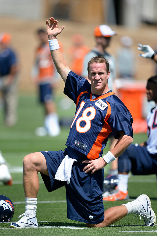 . Denver Broncos Peyton Manning (18) stretches during OTAs June 10, 2014 at Dove Valley. (Photo by John Leyba/The Denver Post)