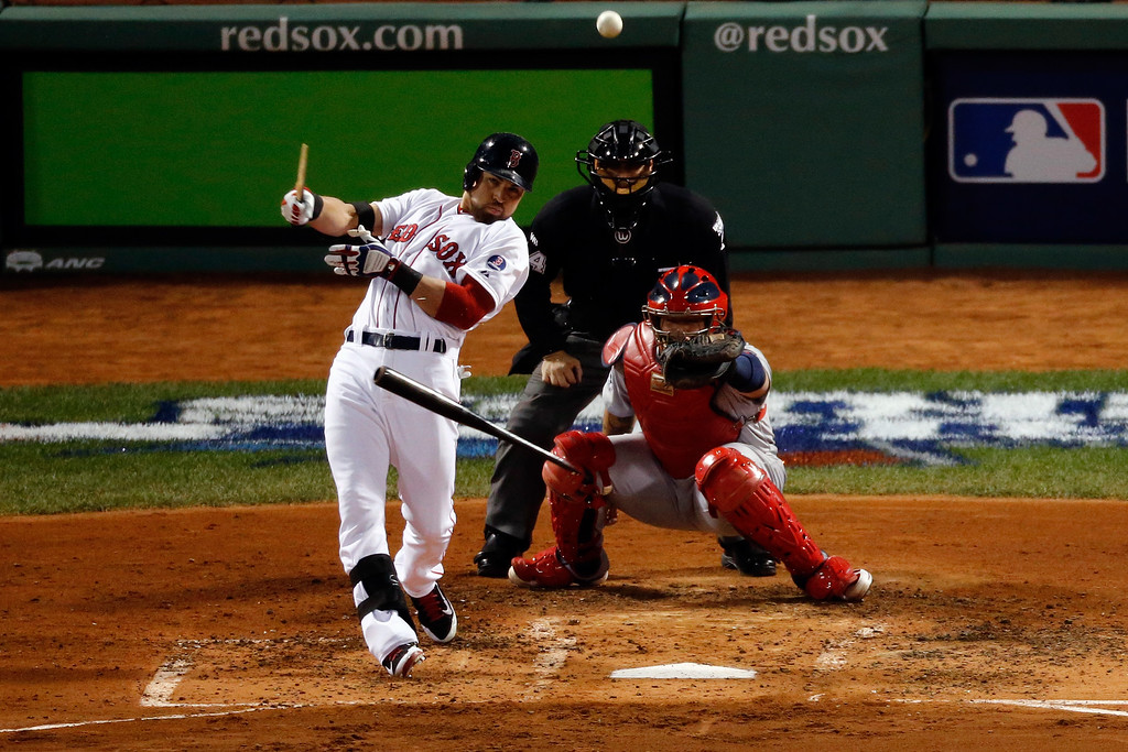 . Jacoby Ellsbury #2 of the Boston Red Sox breaks his bat against the St. Louis Cardinals during Game Two of the 2013 World Series at Fenway Park on October 24, 2013 in Boston, Massachusetts.  (Photo by Jim Rogash/Getty Images)
