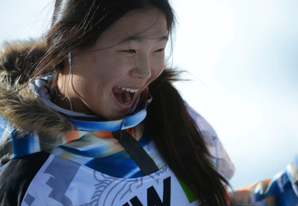 . Pro Snowboarder, Chloe Kim, 13-years-old, is all smiles as she celebrates her podium finish at Breckenridge during the Dew Tour Ion Mountain superpipe championship finals at Breckenridge Saturday afternoon, December 14, 2013. Kim placed third with a score of 89.40 (Photo By Andy Cross/The Denver Post)