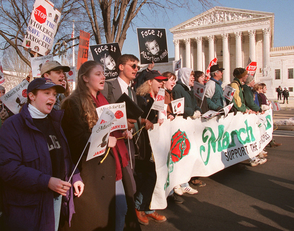 . Abortion opponents march in front of the Supreme Court in Washington Monday Jan. 22, 1996 during their 23rd annual march against the court\'s decision to legalize abortion. The group used this year\'s protest to urge President Clinton to sign legislation limiting a woman\'s right to abortion. (AP Photo/Doug Mills)