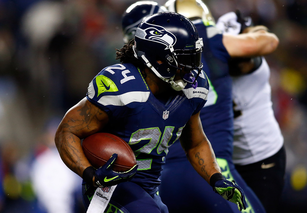 . Running back Marshawn Lynch #24 of the Seattle Seahawks carries the ball against the New Orleans Saints during a game at CenturyLink Field on December 2, 2013 in Seattle, Washington.  (Photo by Jonathan Ferrey/Getty Images)