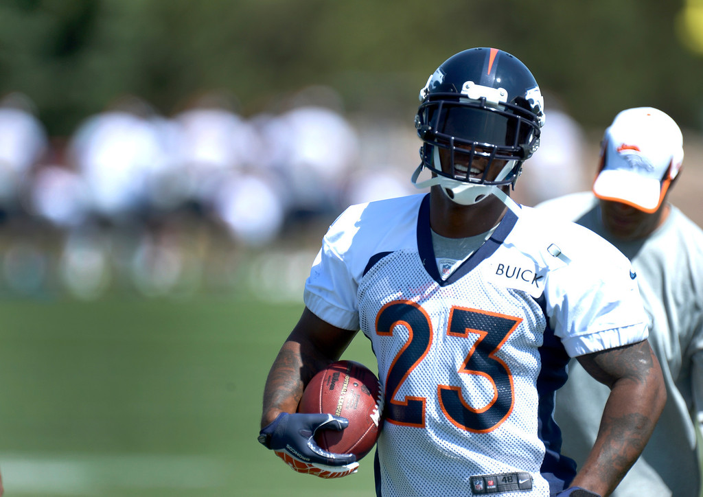 . Running back Willis McGahee of the Denver Broncos works on drills during mini camp June 11, 2013 at Dove Valley. (Photo By John Leyba/The Denver Post)
