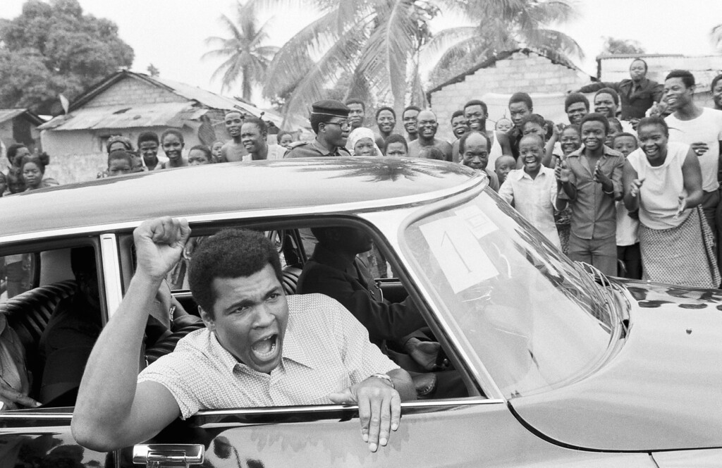 . Boxer Muhammad Ali on a sightseeing tour downtown Kinshasa, Zaire  September 17, 1974.    Ali is scheduled to meet opponent George Foreman on Sept. 24, but the fight had to be delayed until October 30, 1974 because a Foreman injury.           (AP Photo)