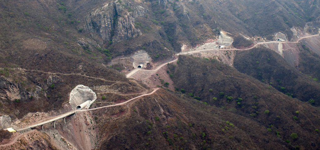 . This June 11, 2013 photo, shows an aerial view of a section of the Durango-Mazatlan highway in the western Sierra Madre near Concordia, Mexico. The highway vies to be one of Mexico\'s greatest engineering feats, designed to bring people, cargo and legitimate commerce safely through a mountain range known until now for marijuana, opium poppies and an accident-prone road called the Devil\'s Backbone. (AP Photo/Dario Lopez-Mills)