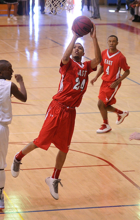 . DENVER, CO. - FEBRUARY 16: Angels guard Dominique Collier launches an off-balance jump shot in the first half. The Denver East High School boy\'s basketball team defeated George Washington 82-20 Saturday afternoon, February 16, 2013.  (Photo By Karl Gehring/The Denver Post)