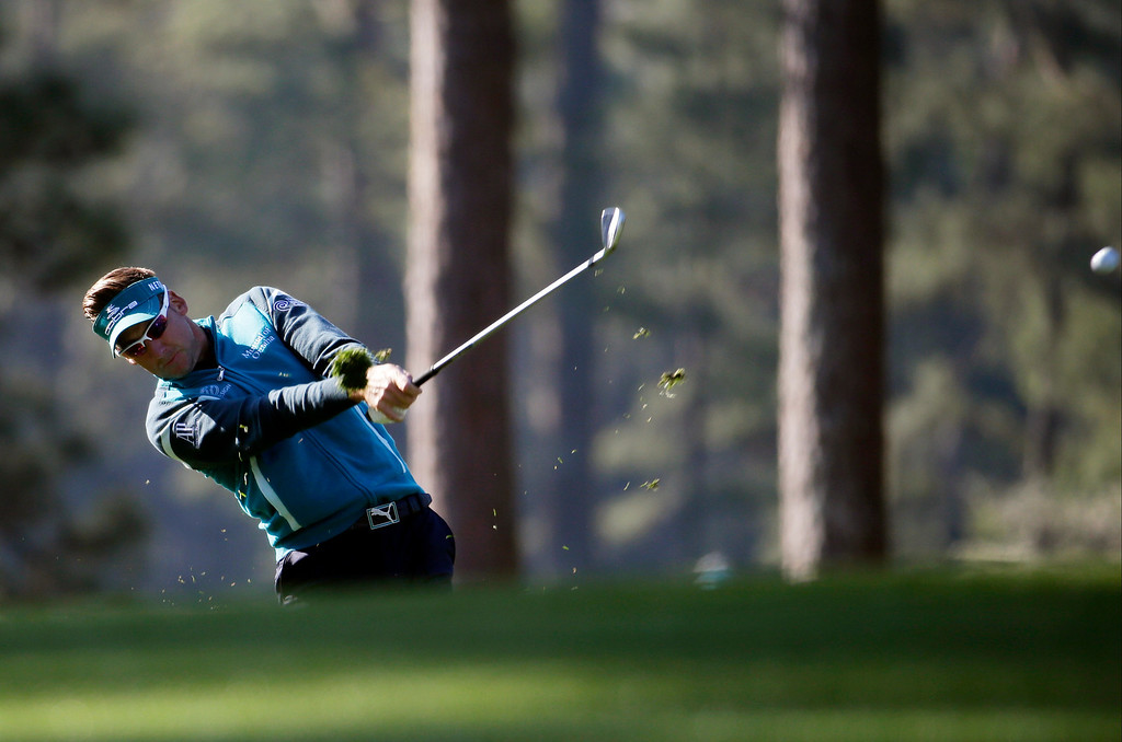 . Ian Poulter, of England, hits off the first fairway during the first round of the Masters golf tournament Thursday, April 10, 2014, in Augusta, Ga. (AP Photo/Darron Cummings)