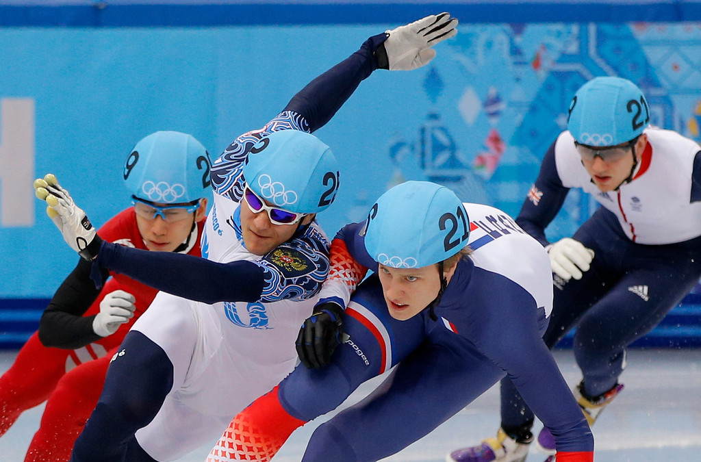 . Vladimir Grigorev of Russia, second from left, squeezes past Han Tianyu of China, left, and Sebastien Lepape of France in a men\'s 500m short track speedskating heat at the Iceberg Skating Palace during the 2014 Winter Olympics, Tuesday, Feb. 18, 2014, in Sochi, Russia. (AP Photo/Vadim Ghirda)