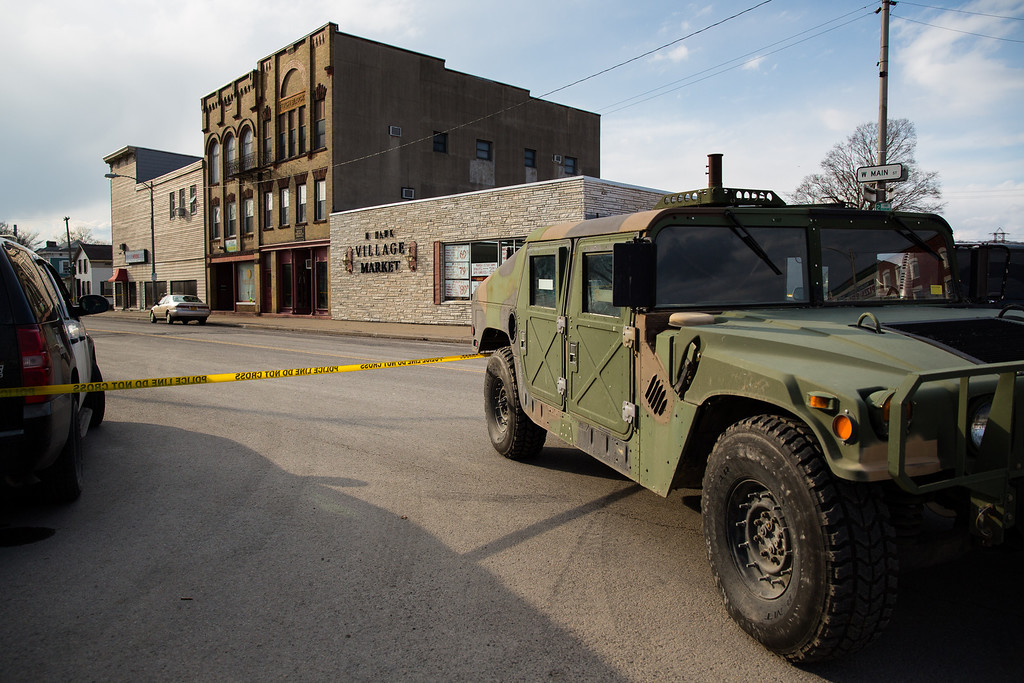 . A military-style vehicle sits on West Main Street as part of a road block related to the shooting spree that left four dead and two wounded in the area on March 13, 2013 in Mohawk, New York. (Photo by Brett Carlsen/Getty Images)