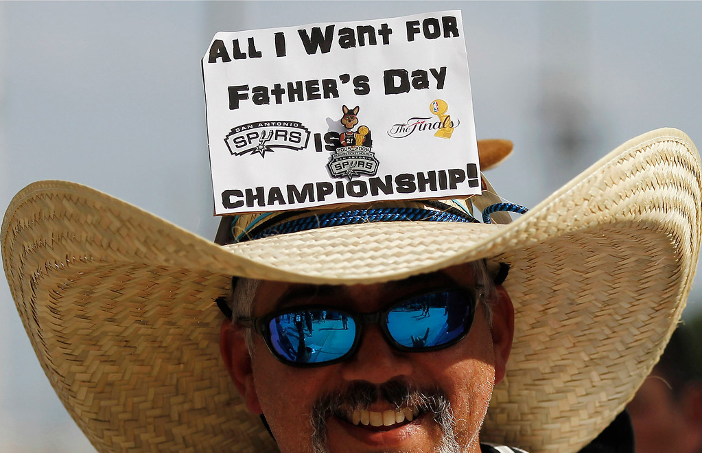 . San Antonio Spurs fan Andy Perez shows his support for the team before Game 5 of the NBA basketball finals against the Miami Heat on Sunday, June 15, 2014, in San Antonio. (AP Photo/Tony Gutierrez)