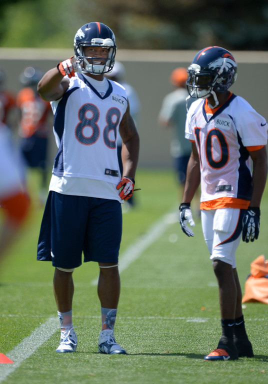 . Denver Broncos wide receiver Demaryius Thomas (88) talks with Emmanuel Sanders (10) during OTAs June 10, 2014 at Dove Valley. (Photo by John Leyba/The Denver Post)