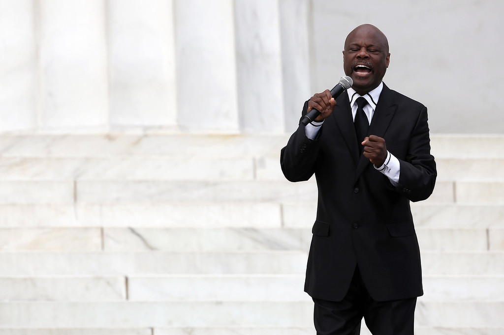 ". Seventh-day Adventist minister and vocal artist Rev. Wintley Phipps, Sr., sings during the Let Freedom Ring ceremony at the Lincoln Memorial August 28, 2013 in Washington, DC. The event was to commemorate the 50th anniversary of Dr. Martin Luther King Jr.\'s ""I Have a Dream\"" speech and the March on Washington for Jobs and Freedom.  (Photo by Alex Wong/Getty Images)"