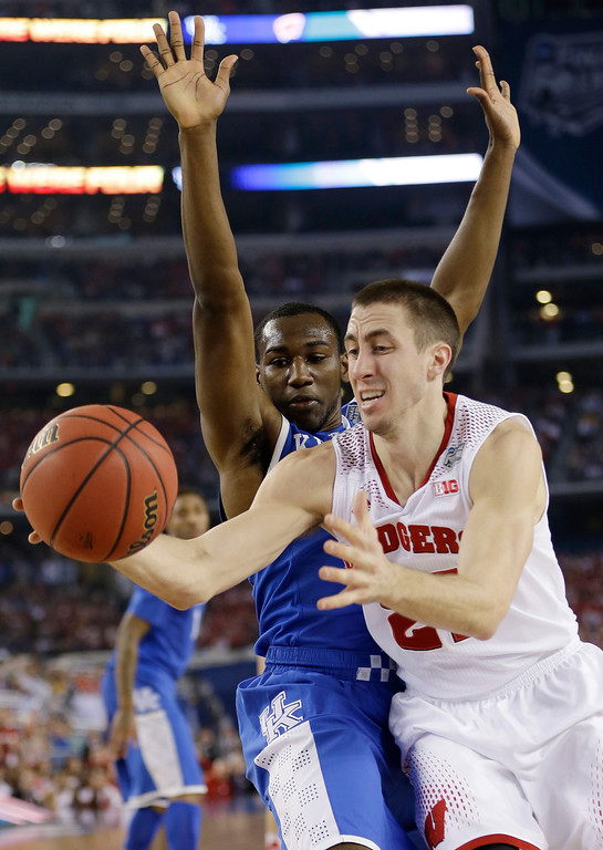 . Wisconsin guard Josh Gasser, right, drives to the basket past Kentucky guard Dominique Hawkins during the first half of an NCAA Final Four tournament college basketball semifinal game Saturday, April 5, 2014, in Arlington, Texas. (AP Photo/David J. Phillip)