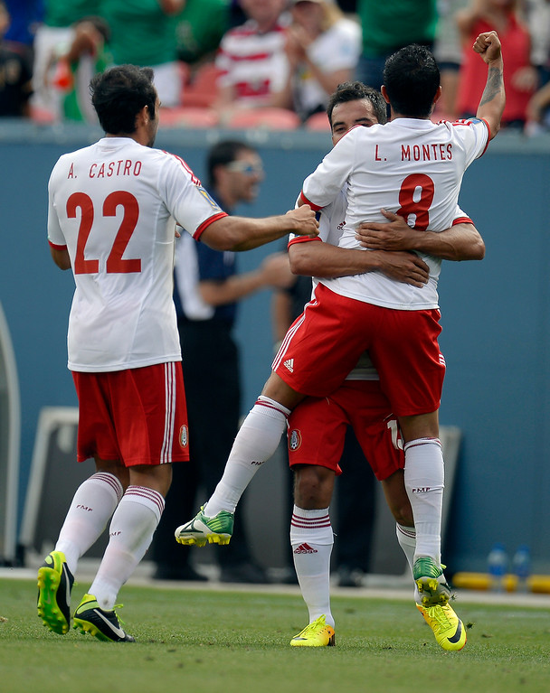 . luis Montes #8 of Mexico pumps his fist celebrating his goal with Adrian Aldrete #13 during the first half in the CONCACAF Gold Cup soccer game against Martinique July 14, 2013 at Sports Authority Field at Mile High. (Photo By John Leyba/The Denver Post)