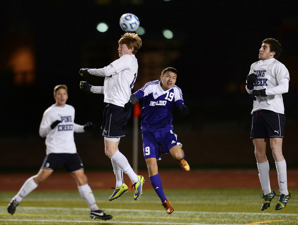 . Zach Peterschmidt of Pine Creek High School (12) header against Jaime Astorga of Boulder High School (19) in the first half of the 5A semifinal game at Legacy Stadium in Aurora, Colorado, on November 6, 2013. (Photo by Hyoung Chang/The Denver Post)