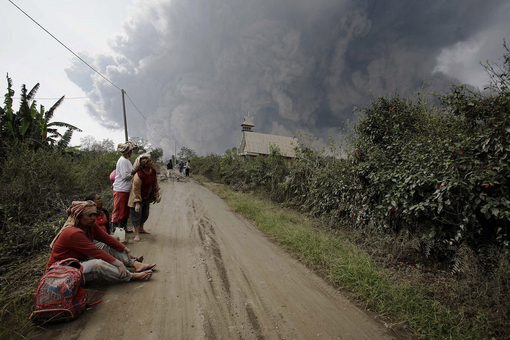 . Residents rest after evacuating from villages engulfed by giant volcanic ash clouds in Karo district during the eruption of Mount Sinabung volcano located in Indonesia\'s Sumatra island on February 1, 2014.  AFP PHOTO / CHAIDEER MAHYUDDIN/AFP/Getty Images