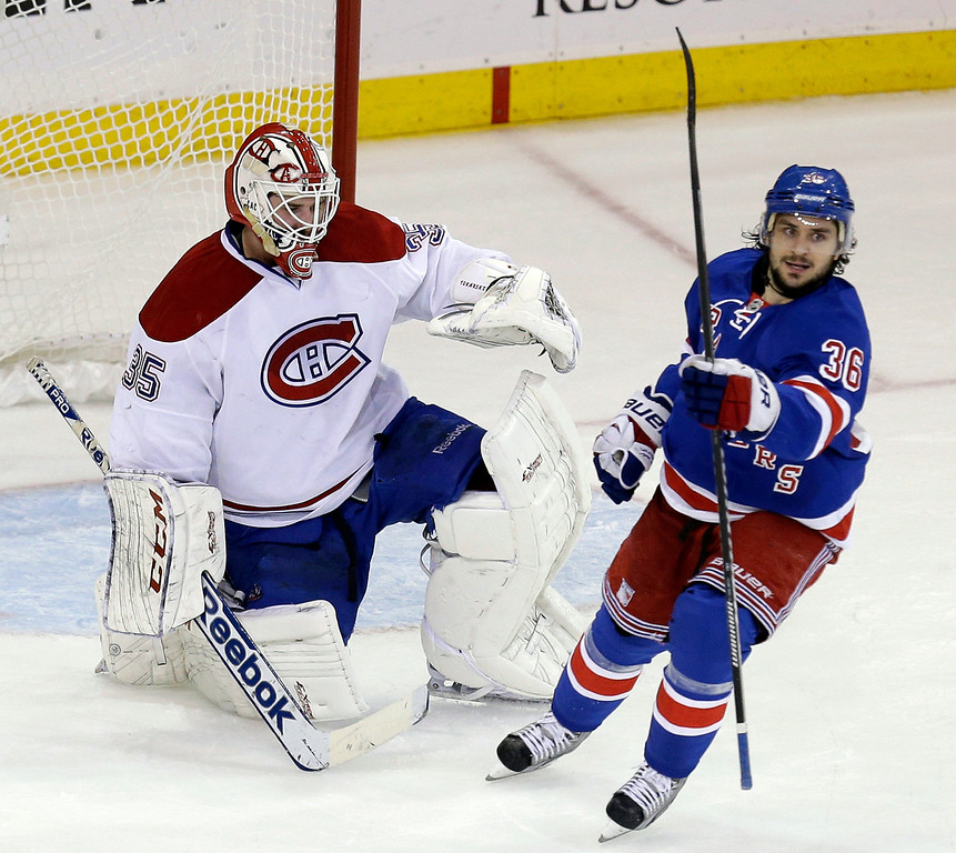 . Montreal Canadiens goalie Dustin Tokarski, left, and New York Rangers\' Mats Zuccarello react after New York Rangers\' Derick Brassard scored during the second period of Game 4 of the NHL hockey Stanley Cup playoffs Eastern Conference finals, Sunday, May 25, 2014, in New York. (AP Photo/Seth Wenig)