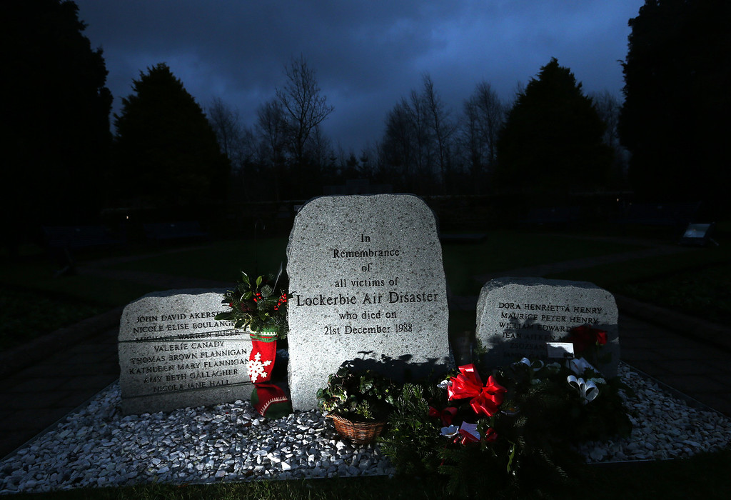 . Floral tributes are seen near the main memorial stone in memory of the victims of Pan Am flight 103 bombing in the garden of remembrance at Dryfesdale Cemetery, near Lockerbie, Scotland, Saturday, Dec. 21, 2013.  (AP Photo/Scott Heppell).